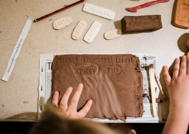 Aerial shot over a child working with clay.