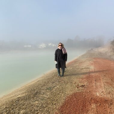 Dena Bagi standing in front of a steaming lake in Venice.