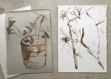 A drawing of a plant pot and flowers stems made using coffee inks.