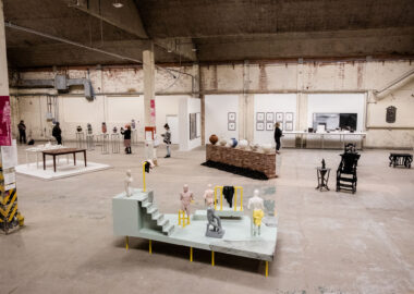 An image of the AWARD exhibition taken during the 2019 British Ceramics Biennial Festival. The image is taken high up and shows various ceramic artworks and installations.