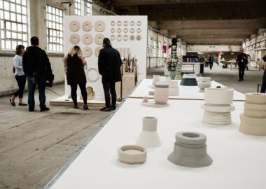 Delicately turned ceramics in pastel shades are displayed on tables in the Spode China Hall as part of British Ceramics Biennial 2019 festival.