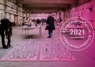 Visitors look at ceramic art being exhibited at British Ceramics Biennial 2019 in Spode China Hall.