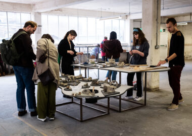 A group of young people play with clay and tools at British Ceramics Biennial 2019.