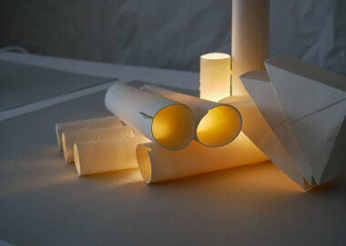 Porcelain ceramic tubes are gently lit by yellow